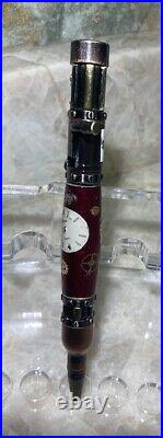 Custom Hand Made Steampunk Bolt Action Watch Parts Ruby Red Background