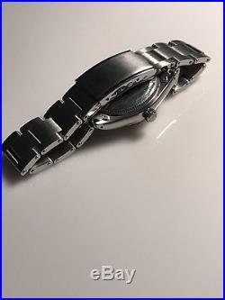 Genuine Rolex 6564 316L Stainless Steel Case, Dial, Hands & Rivet Bracelet