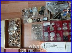 Huge lot of mechanisms, hands and parts for watches and watchmakers