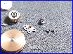 Omega 683 lot of watch parts. Hand. Screws. 3.85mm yellow crown. Rotor. Barrel