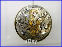 Universal Geneve Unicompax Cal 285 movement running with dial and hands