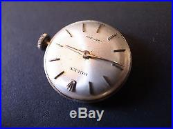 Vintage Rolex 1400 watch movement with silver dial hands crown and holder ring